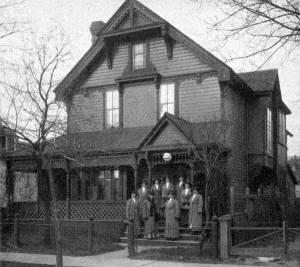 Staff of nurses on the front steps of the Margaret Scott Nursing Mission at 99 George Street, Winnipeg.