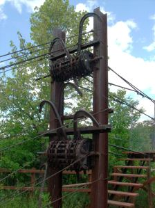 Structural support for swinging bridge over Roseau