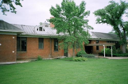 Rear of Anna Gibson School with arches dormer and breezeway entrance