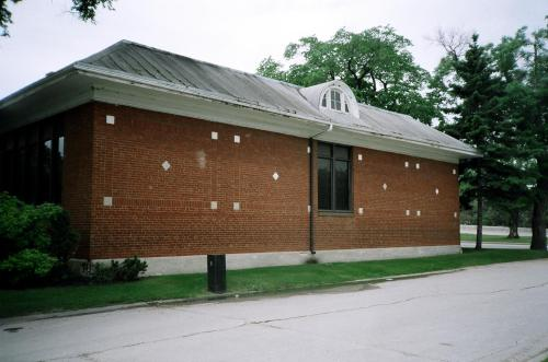 Side view of Anna Gibson School with diamond patterns and limestone flashes.