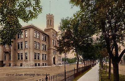 A postcard view of Carlton School and its tower with crenellated crown over an open arcade. Note on left the spiral fire escape. There was one on each side of the school.