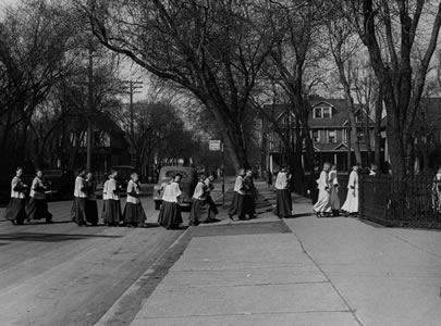 St. Mary's School students crossing the street to St. Mary's Cathedral, ca 1930